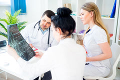 Group of doctors looking at xray Stock Images