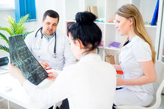 Group of doctors looking at xray Stock Photos