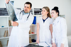 Group of doctors looking at xray Stock Photo