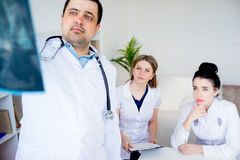 Group of doctors looking at xray Stock Image