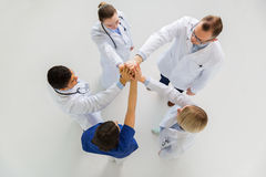 Group of doctors making high five at hospital Royalty Free Stock Photo