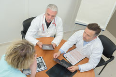 Group doctors meeting at medical office. Group of doctors meeting at medical office Royalty Free Stock Photography