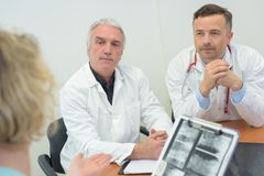 Group doctors meeting at medical office. Group of doctors meeting at medical office Royalty Free Stock Photo
