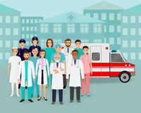 Group of doctors and nurses and ambulance car on cityscape background. Emergency medical service employee. Stock Images