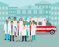 Group of doctors and nurses and ambulance car on cityscape background. Emergency medical service employee. Stock Photo