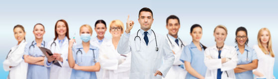 Group of doctors and nurses with clipboard stock photos