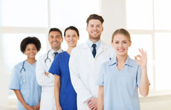 Group of doctors and nurses at hospital Stock Images