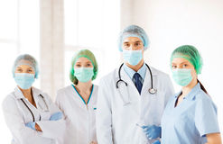 Group of doctors in operating room Stock Images