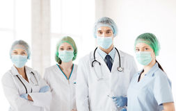Group of doctors in operating room Stock Photos
