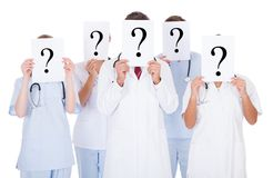 Group of doctors with question mark sign Royalty Free Stock Images