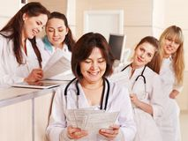 Group doctors at reception in hospital. Stock Photos