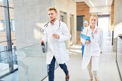Group doctors are running fast in an emergency stock photos