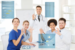 Group of doctors showing ok hand sign at hospital Royalty Free Stock Photography