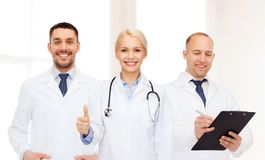 Group of doctors showing thumbs up in clinic Stock Image