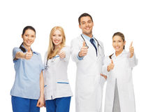 Group of doctors showing thumbs up Royalty Free Stock Images
