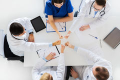 Group of doctors showing thumbs up over table Stock Photo