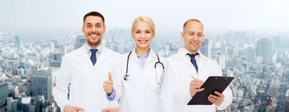 Group of doctors showing thumbs up over white Royalty Free Stock Photos