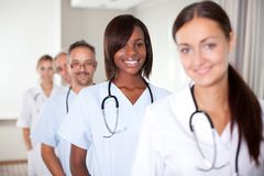 Group of doctors standing at a hospital in a row Royalty Free Stock Photo
