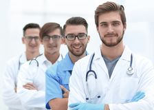 Group of doctors standing at the medical office stock photography