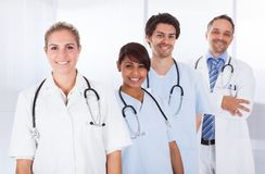Group of doctors standing together over white Royalty Free Stock Photo
