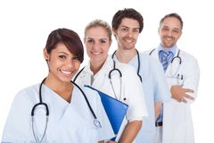Group of doctors standing together over white Royalty Free Stock Images