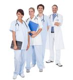 Group of doctors standing together over white Stock Image