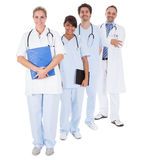 Group of doctors standing together over white Royalty Free Stock Photography