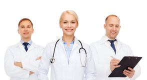 Group of doctors with stethoscopes and clipboard Stock Photos