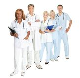 Group of doctors and surgeons isolated on white Stock Images
