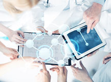 Group of doctors with tablet pc and clipboard Stock Photo