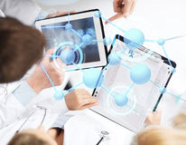 Group of doctors with tablet pc and clipboard Stock Images