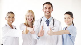 Group of doctors with thumbs up stock video