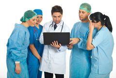 Group of doctors using laptop. Group of five doctors having conversation and using a laptop isolated on white background Stock Images