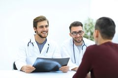 Group of doctors welcoming their customer with a handshake. The concept of professionalism Stock Images