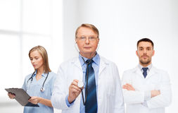 Group of doctors in white coats Stock Photo