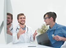 Group of doctors at a working meeting. In medical office Stock Images