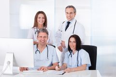 Group Of Doctors Working Together Stock Photos