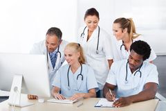 Group of doctors working together Stock Photo