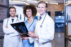 Group of doctors with xray report Stock Photography