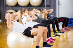 Group does abdominal exercises for core strength Stock Image