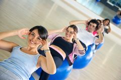 Group doing abs exercises Royalty Free Stock Photography