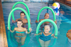 Group doing aqua fitness class in pool Royalty Free Stock Photos