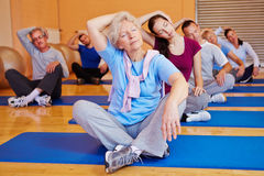 Group doing back exercises stock photo