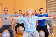 Group doing dumbbell exercises Stock Photography
