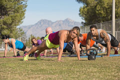 Group Doing Push-Ups with Instructor Royalty Free Stock Photos
