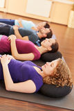 Group doing relaxation exercises. Group doing some relaxation exercises in a health club Royalty Free Stock Photos