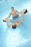 Group doing water yoga in pool Royalty Free Stock Image