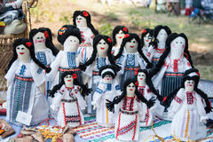Group of doll women and girls in traditional Moldovan clothes Stock Images