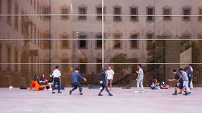 Young boys dancing at CCCB Barcelona. A group of dominican boys and girls practise modern fashion dancing in front of the CCCB, Centre de Cultura Contemporà royalty free stock photography