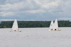 Group of dragon yacht sail in regatta near a buoy . Royalty Free Stock Images